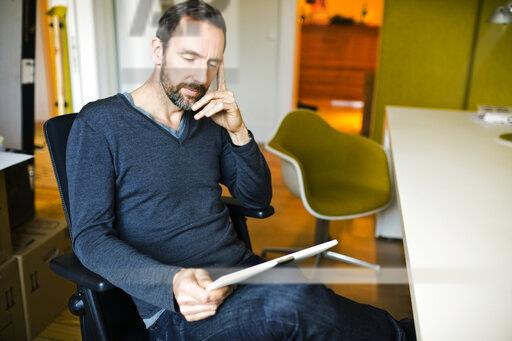 Businessman using tablet at desk in office