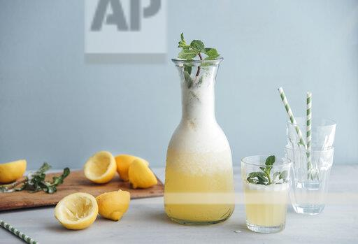 Homemade lemonade sweetened with honey in carafe and glass