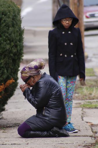 Carla Brown Left Prays As Her Daughter Stands By In Front Of A House Friday March 11 2016 Where Shooting At Backyard Party Killed And Wounded
