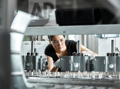 Young woman checking production line on a conveyor belt