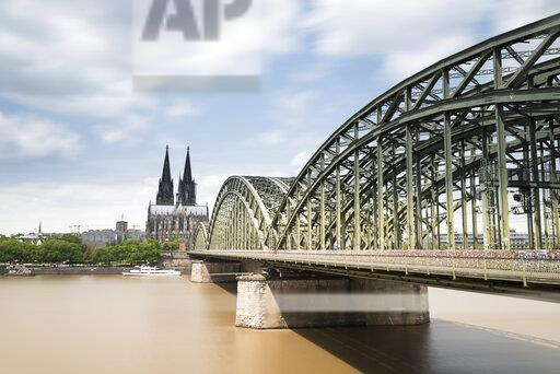 Germany, Cologne, view to Cologne Cathedral with Hohenzollern Bridge and River Rhine in the foreground