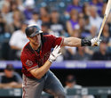 Arizona Diamondbacks' Paul Goldschmidt follows the flight of his double off Colorado Rockies starting pitcher Jon Gray in the second inning of a baseball game Wednesday, Sept. 12, 2018, in Denver. (AP Photo/David Zalubowski)