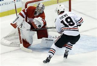 Jimmy Howard (35) , Jonathan Toews