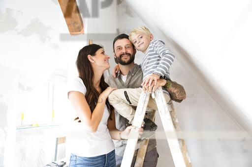 Portrait of happy family working on loft conversion