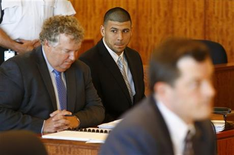 Former NFL player Aaron Hernandez (C) appears for a hearing in Bristol County Superior Court in Fall River