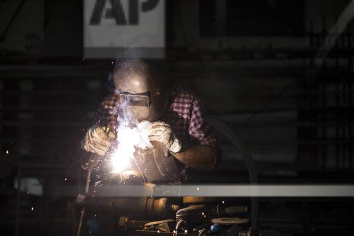 Man welding in his workshop