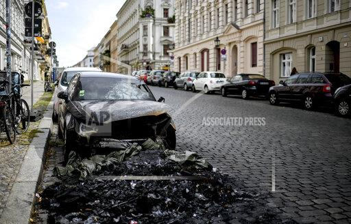 Burnt-out cars in the miners' district