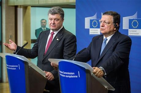 European Commission President Jose Manuel Barroso, right, and Ukraine's President Petro Poroshenko address the media after a meeting at the European Commission headquarters in Brussels on Saturday, Aug. 30, 2014. At a summit on Saturday EU leaders will discuss who will get the job as the 28-nation bloc's foreign policy chief for the next 5 years and the situation in Ukraine. (AP Photo/Geert Vanden Wijngaert)