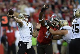 Gerald McCoy, Drew Brees