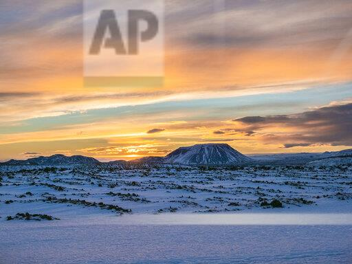 Iceland, snowy landscape surronding Krafla volcano and mountain in winter by sunrise