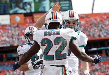 Ryan Tannehill, Reggie Bush