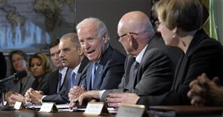 Joe Biden, Eric Holder