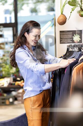 Mature woman shopping for clothes in a fashion store
