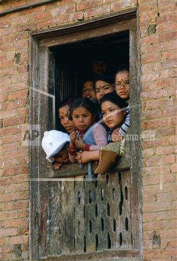 Creative Robert Harding Productions /AP Images A   Nepal 1161-906 Family  at window  to watch festival in Bhaktapur, Nepal