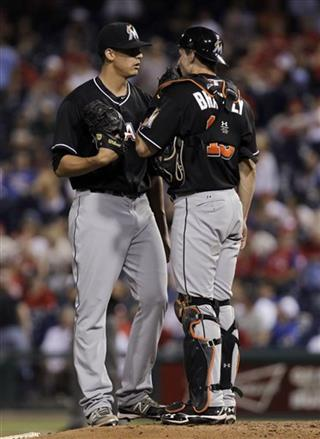 Edgar Olmos,  Rob Brantly