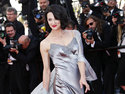 FILE - In this May 26, 2013 file photo, actress Asia Argento arrives for the awards ceremony of the 66th international film festival, in Cannes, southern France. Argento, one of the most prominent activists of the #MeToo movement against sexual harassment, recently settled a complaint filed against her by a young actor and musician who said she sexually assaulted him when he was 17, the New York Times reported. (Photo by Joel Ryan/Invision/AP, File)