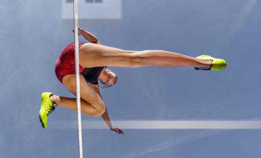Female hurdler, worm's eye view