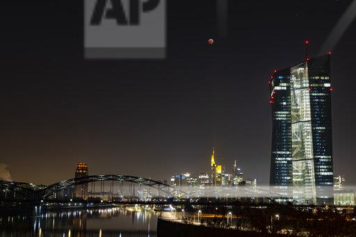 Germany, Frankfurt on Main, view to lighted skyline and European Central Bank at total lunar eclipse