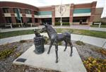 In this Monday, Nov. 6, 2017, photo, a sculpture stands outside the front door of the veterinary school at Colorado State University in Fort Collins, Colo. Two researchers at the school are leading efforts to determine the efficacy of using CBD oil in the treatment of dogs with epilepsy and arthritis. (AP Photo/David Zalubowski)