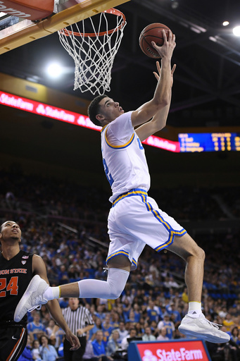 be54edcb238 12, 2017, file photo, UCLA guard Lonzo Ball, top, shoots as Oregon State  guard Kendal Manuel, left, watches during the second half of an NCAA  college ...