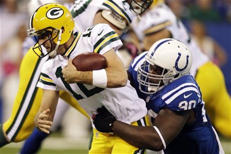 Aaron Rodgers,  Cory Redding