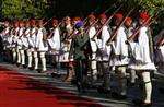 A Greek Presidential Guard officer inspects the evzones prior to the official welcome ceremony for Turkey's President Recep Tayyip Erdogan, in Athens, Thursday, Dec. 7, 2017. Erdogan is in Greece on atto-day official visit. (AP Photo/Thanassis Stavrakis)