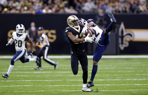 9c1c84b82 4, 2018, file photo, New Orleans Saints wide receiver Michael Thomas (13)  pulls in a pass against Los Angeles Rams cornerback Marcus Peters (22) during  the ...