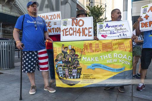 Say No to ICE, Amazon, and Whole Foods | Buy Photos | AP
