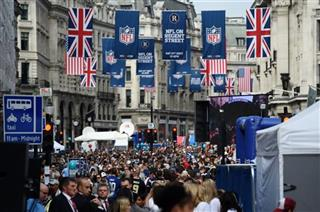 Britain Raiders Dolphins Football
