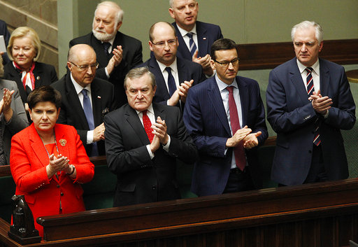 In this Dec. 5, 2017 photo Poland's Prime Minister Beata Szydlo, front left and Finance Minister Mateusz Morawiecki, front second right, attend a parliament session in Warsaw, Poland.Poland's conservative ruling party said Thursday, Dec. 7, 2017 that Polish Prime Minister, Beata Szydlo, has resigned and will be replaced by Morawiecki. (AP Photo/Czarek Sokolowski)