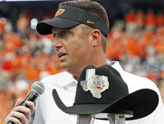 Oklahoma State head coach Mike Gundy talks during the trophy presentation for the Advocare Texas kickoff game.
