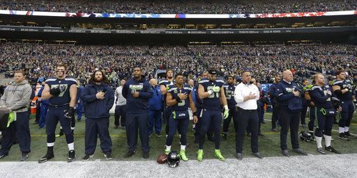 ad3aa8969da5 The Latest  Group of Seahawks kneel before game against Rams