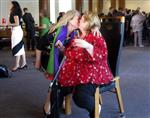 Australian Sen. Louise Pratt, left, kisses actress Magda Szubanski at Parliament House in Canberra, Australia, Thursday, Dec. 7, 2017. The Parliament voted Thursday to allow same-sex marriage across the nation, following a bitter debate settled by a much-criticized government survey of voters that strongly endorsed change. (AP Photo/Rod McGuirk)