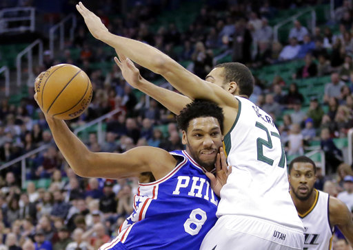 FILE - In this Dec. 29, 2016, file photo, Philadelphia 76ers center Jahlil Okafor (8) drives to the basket as Utah Jazz center Rudy Gobert (27) defends in the first half during an NBA basketball game in Salt Lake City. A person familiar with the deal says 76ers are set to trade beleaguered center Okafor to the Brooklyn Nets. (AP Photo/Rick Bowmer, File)