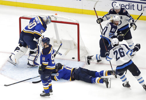 a7ba9550b3e Connor scores in OT as Jets beat Blues 2-1 to even seri ...