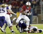 FILE - In this Nov. 10, 2017, file photo, Stanford 's Bryce Love (20) runs against Washington during the first half of an NCAA college football game, in Stanford, Calif. Love was selected to the AP All-Conference Pac-12 team announced Thursday, Dec. 7, 2017. (AP Photo/Marcio Jose Sanchez, File)