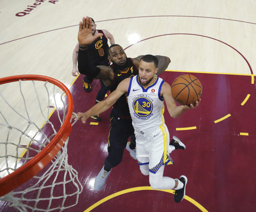 9e73584285d2 Golden State Warriors  Stephen Curry shoots next to Cleveland Cavaliers   LeBron James during the second half of Game 3 of basketball s NBA Finals