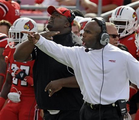 Charlie Strong, Clint Hurtt