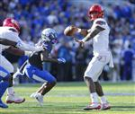 Louisville quarterback Lamar Jackson throws a touchdown pass to wide receiver Dez Fitzpatrick during the first half of an NCAA college football game against Kentucky, Saturday, Nov. 25, 2017, in Lexington, Ky. (AP Photo/David Stephenson)