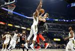 Chicago Bulls forward Lauri Markkanen (24) shoots over Indiana Pacers center Myles Turner during the first half of an NBA basketball game in Indianapolis, Wednesday, Dec. 6, 2017. (AP Photo/Michael Conroy)