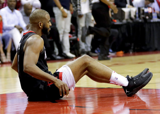 fa2b8e4b3794 Houston Rockets guard Chris Paul sits on the floor after being hurt during  the second half in Game 5 against the Golden State Warriors in the NBA  basketball ...