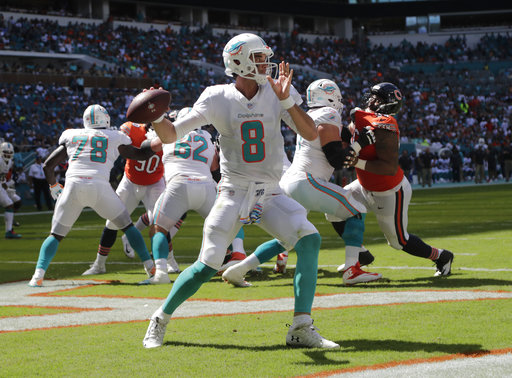 Miami Dolphins quarterback Brock Osweiler (8) looks to pass during the  first half of an NFL football game against the Chicago Bears e2946aee0