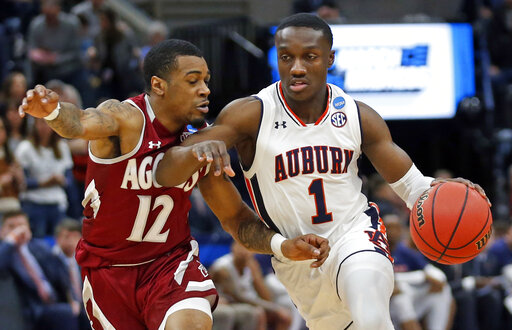 617ebc13b434 Auburn Tigers guard Jared Harper (1) drives as New Mexico State guard AJ  Harris (12) defends in the first half during a first round men s college  basketball ...