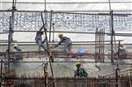 In this Tuesday, Dec. 5, 2017, photo, workers peel off the application of fuller's earth or locally called multani mitti from the walls of the Taj Mahal during its cleaning process caused by environmental pollution in Agra, India. Authorities in India are trying to figure out how workers will scale the Taj Mahal's majestic but delicate dome as they complete the first thorough cleaning of the World Heritage site since it was built 369 years ago. Work on the mausoleum's minarets and walls is almost finished, after workers began the makeover in mid-2015. They've been using a natural mud paste to remove yellow discoloration and return the marble to its original brilliant white. (AP Photo/Manish Swarup)