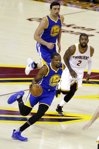 f1e652ce407 Golden State Warriors forward Kevin Durant (35) drives on Cleveland  Cavaliers guard Kyrie Irving (2) during the first half of Game 3 of  basketball s NBA ...