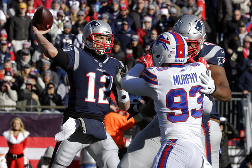 19af12ee7 New England Patriots quarterback Tom Brady (12) passes under pressure from  Buffalo Bills defensive end Trent Murphy (93) during the first half of an  NFL ...