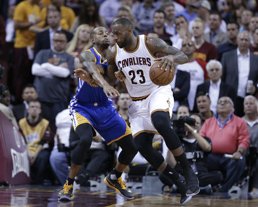 1252a5e96891 Cleveland Cavaliers forward LeBron James (23) drives on Golden State  Warriors forward Andre Iguodala during the first half of Game 3 of  basketball s NBA ...