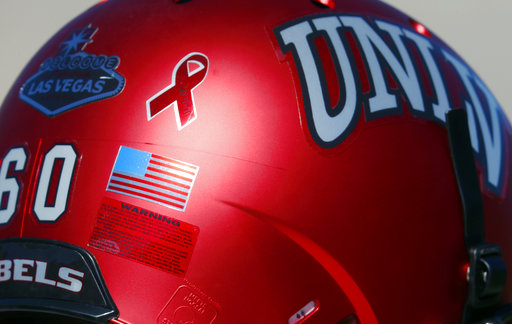 Andrew Erbes helmet with commemorative ribbon for Las Vegas shooting victims