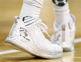 Emmanuel Omogbo tributes written on his basketball shoes