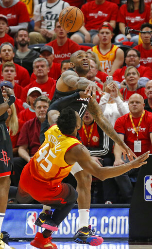 473b3164ecf Houston Rockets forward PJ Tucker (17) blocks the shot of Utah Jazz guard  Donovan Mitchell (45) in the first half during an NBA basketball game  Saturday, ...